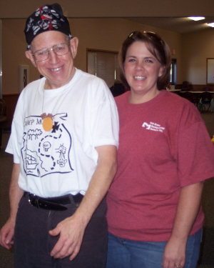 Woman and man standing next to each other, smiling